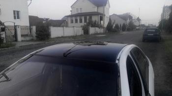 Оклейка крыши RENAULT Laguna в черную глянцевую пленку