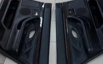 Оклейка дверных карт в черную эко кожу  BMW 7